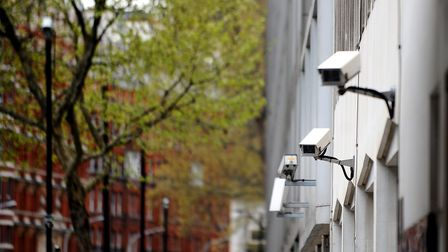 A stock picture of CCTV cameras on the side of a building in central London.