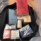Police have seized a bag of counterfeit perfume from an Ipswich street trader