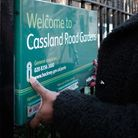 Cassland Road Gardens sign being removed.