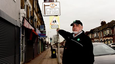 Farooque Azad by the street restriction sign on Green Lane that had been turned around to face the o
