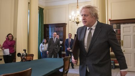 Prime Minister Boris Johnson arriving in the Cabinet Room