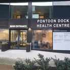 The main entrance to Pontoon Dock Health Centre at Royal Wharf.