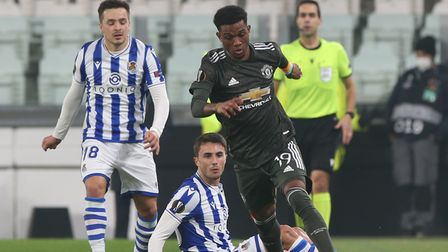 Amad Diallo, of Manchester United, evades twoReal Sociedad players during the sides' recent Europa League clash