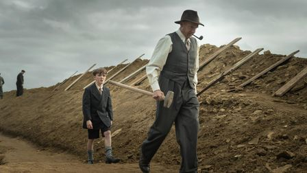 Ralph Fiennes as Basil Brown in The Dig.
