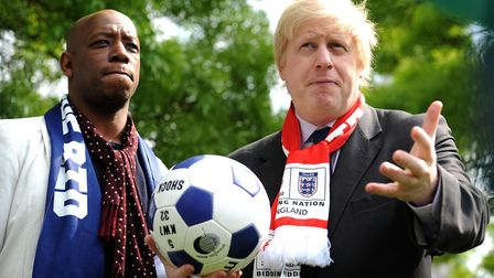Boris Johnson (right) speaks to media with ex-footballer Ian Wright ahead of a bid for the World Cup