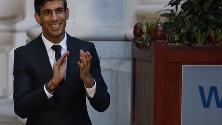 Chancellor of the Exchequer Rishi Sunak clapping outside the Foreign and Commonwealth Office in London to salute local...