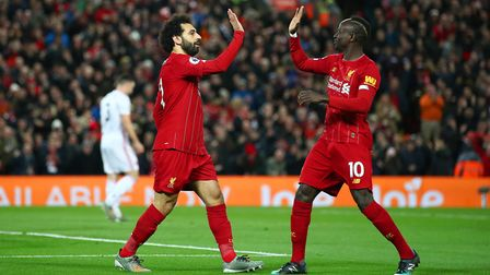 Mohamed Salah of Liverpool celebrates with Sadio Mane after scoring his team's first goal during the