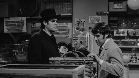 Comedians John Cleese (left) and Michael Palin in the 'Dead Parrot' sketch from series 1 of the BBC