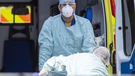 An ambulance worker wears PPE during the coronavirus outbreak. Picture: Justin Setterfield/Getty Ima