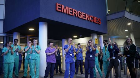 NHS staff applaud themselves and their colleagues at the entrance of the Royal Liverpool Hospital as