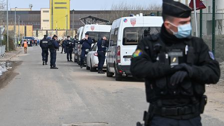 Riot police forces are at work as part of an operation to shelter migrants on a voluntary basis in a