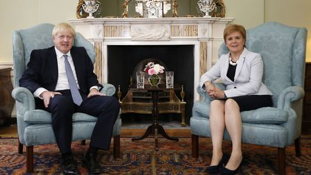 Britain's Prime Minister Boris Johnson (L) and Scotland's First Minister Nicola Sturgeon (R) pose for a photograph before...