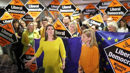 Jo Swinson appears in front of EU flags and Lib Dem signs. Photograph: Aaron Chown/PA.