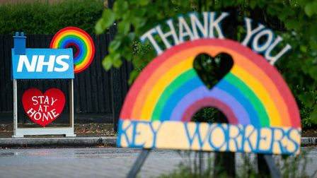 Signs thanking key workers and the NHS. Picture: PA/Aaron Chown