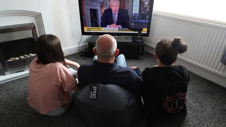 People in a house in Liverpool watch Prime Minister Boris Johnson addressing the nation about corona
