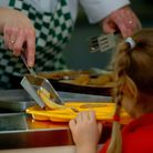 Families eligible for free school meals will be able to claim £25 food vouchers per child over the C
