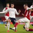 Arsenal's Rob Holding (right) collides with Manchester City's Joao Cancelo resulting in a concussion