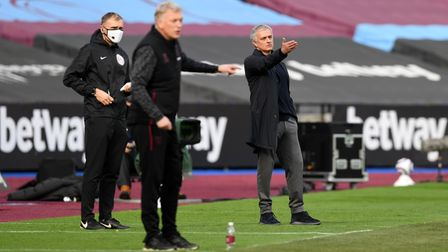 Tottenham Hotspur manager Jose Mourinho (right) gestures on the touchline during the Premier League