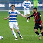 Queens Park Rangers' Rob Dickie (left) and AFC Bournemouth's Arnaut Danjuma (right) battle for the b