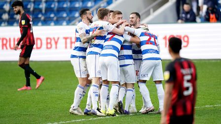 Queens Park Rangers' Todd Kane (hidden) celebrates scoring their second goal of the game with teamma