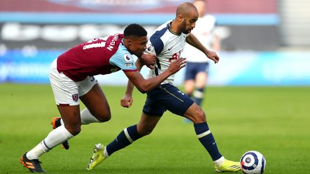 Tottenham Hotspur's Lucas Moura (right) and West Ham United's Ben Johnson battle for the ball during