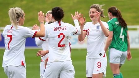 Ellen White of England celebrates with Rachel Daly and Lucy Bronze after scoring their team's second