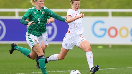 Ellen White of England runs with the ball under pressure from Julie Nelson of Northern Ireland durin