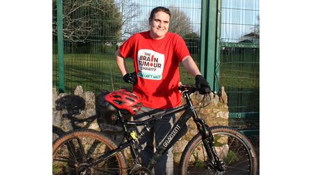 Picture of teenager who has brain tumour preparing for sponsored bike ride