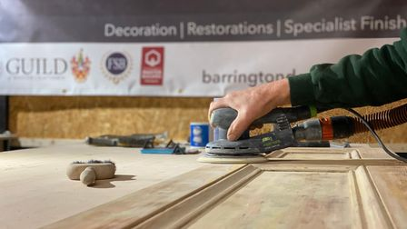 Barrington Decorators working on a piece of furniture in their workshop