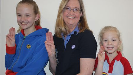 Sally Settle and her daughters renewed their promise on Thinking Day in Welwyn Garden City.