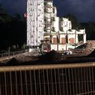 Night-time shot of demolished hotel
