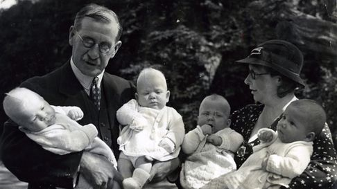 Dr Ernest Harrisson and Doris Miles with the quads.