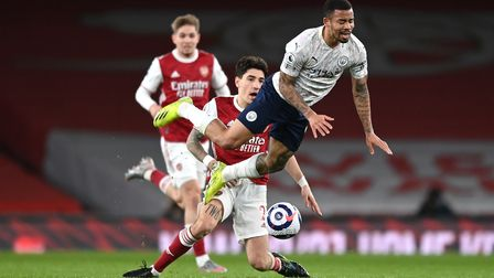 Manchester City's Gabriel Jesus (right) is tackled by Arsenal's Hector Bellerin during the Premier L