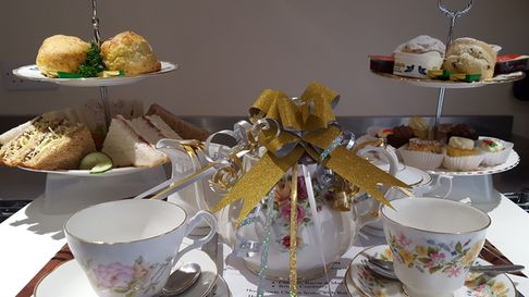 Gift wrapped Afternoon Tea with a loaned China Set from Teapot Catering