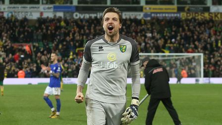 Tim Krul of Norwich celebrates victory at the end of the Premier League match at Carrow Road, Norwic