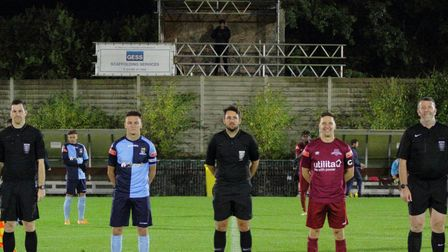 Welwyn Garden City and St Neots Town skippers with match officials