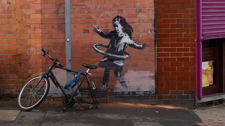 An artwork painted by Banksy on the side of a property at Rothesay Avenue and Ilkeston Road in Notti