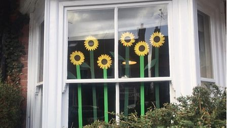 Residents of Burnham Road, St Albans have been revealing flower-based windows each day, comparing it to a spring-like...