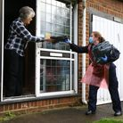 Members of Kent Fire and Rescue Service deliver coronavirus testing kits in Maidstone, Kent, during