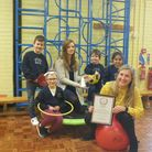 Staff and pupils at Crosshall Infant School, in St Neots, with the new accreditation.