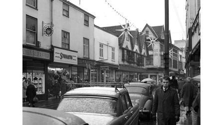 Parked cars in Tavern Street, Ipswich, in December 1963. Shops included Haskell's jewellers, Stuarts clothes shop and A J...