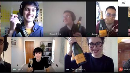 The Seamless Capital team meeting over Zoom online.