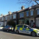 Police vehicles and officers in Eleanor Road, Stratford.