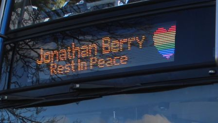 Tributes paid to Jonathan Berry with bus banner and rainbow heart