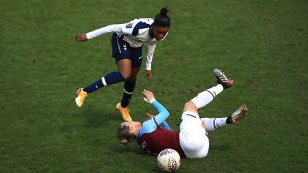 Tottenham Hotspur's Jessica Naz (left) and West Ham United's Gilly Flaherty battle for the ball duri