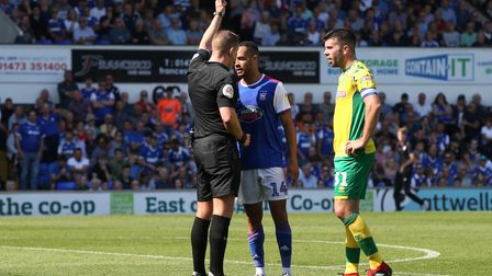 Jordan Graham of Ipswich Town dives and gets a yellow card from Referee Robert Jones during the Sky