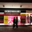 People walking past Debenhams