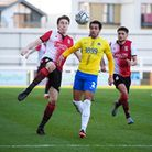 Jack Cook of Woking, Ben Wynter of Torquay United and Kane Ferdinand of Woking compete for possessio
