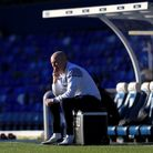 QPR boss Mark Warburton looks on at St Andrew's