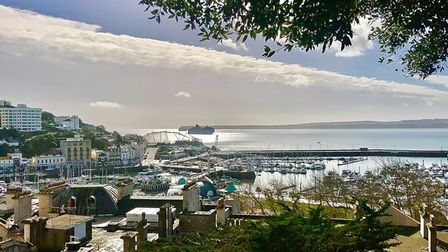 The view from Warren Road steps which look across the Bay taking in a cruise ship and Berry Head